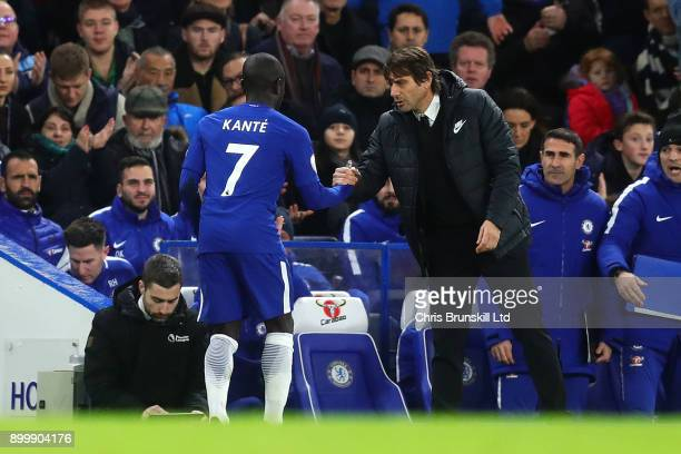 Chelsea manager Antonio Conte shakes hand with N'Golo Kante as he leaves the field after being substituted during the Premier League match between...
