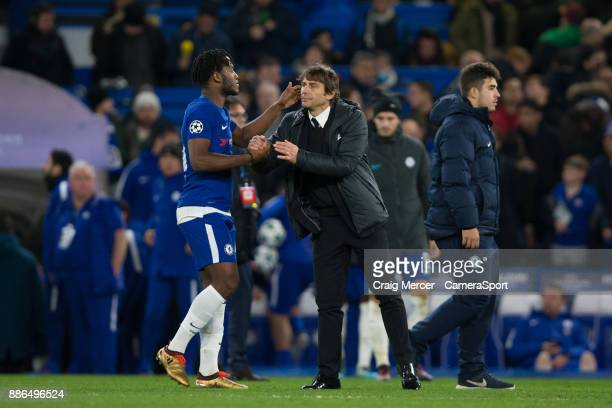 Chelsea manager Antonio Conte shakes hands with Chelsea's Michy Batshuayi after the UEFA Champions League group C match between Chelsea FC and...