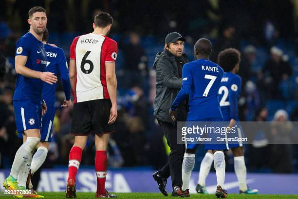 Chelsea manager Antonio Conte shakes hands with Chelsea's Ngolo Kante at full time during the Premier League match between Chelsea and Southampton at...