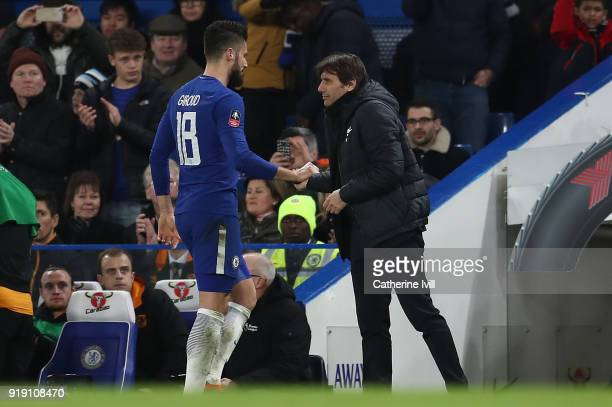 Chelsea manager Antonio Conte shakes hands with Olivier Giroud as he leaves the pitch during The Emirates FA Cup Fifth Round match between Chelsea...