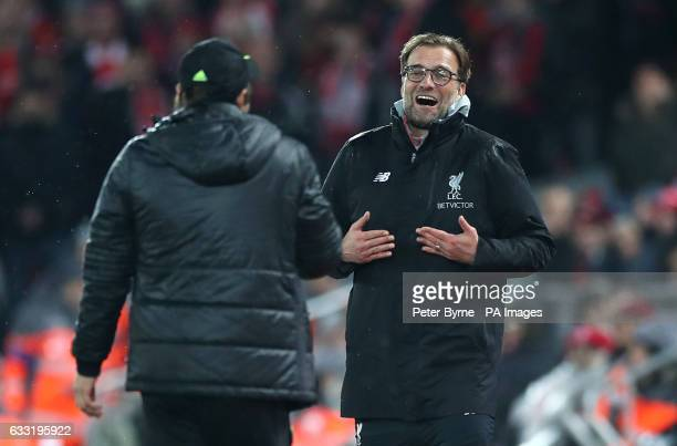 Chelsea manager Antonio Conte shares a joke with Liverpool manager Jurgen Klopp on the touchline during the Premier League match at the Anfield...