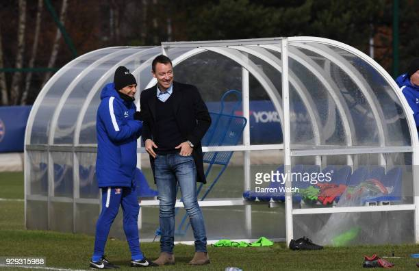 Chelsea Manager Antonio Conte with John Terry during a training session at Chelsea Training Ground on March 8 2018 in Cobham England