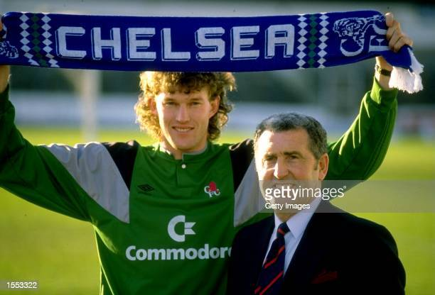Chelsea Manager Bobby Campbell stands alongside his new goalkeeper Dave Beasant who holds a scarf above his head at Stamford bridge in London England...