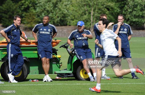 Chelsea manager Carlo Ancelotti and Frank Arnesen look on as Yossi Benayoun trains during a training session at the Cobham Training Ground on July 5,...