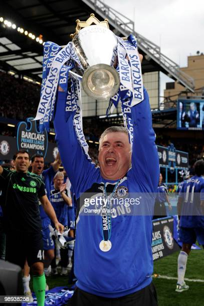 Chelsea manager Carlo Ancelotti celebrates with the trophy after winning the league with an 80 victory during the Barclays Premier League match...