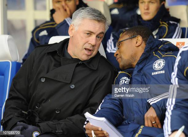 Chelsea manager Carlo Ancelotti speaks with new assistant coach Michael Emenalo ahead of the Barclays Premier League match between Birmingham City...