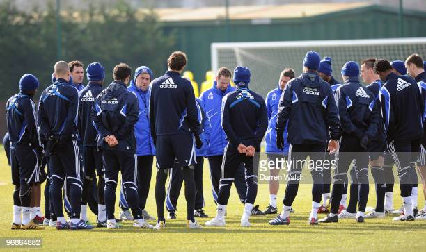 Chelsea manager Carlo Ancelotti talks tactics before a training session at Cobham Training ground on February 19 2010 in Cobham England