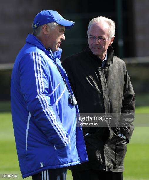 Chelsea manager Carlo Ancelotti talks to Ivory Coast manager Sven-Göran Eriksson during a training session at the Cobham Training Ground on April 1,...