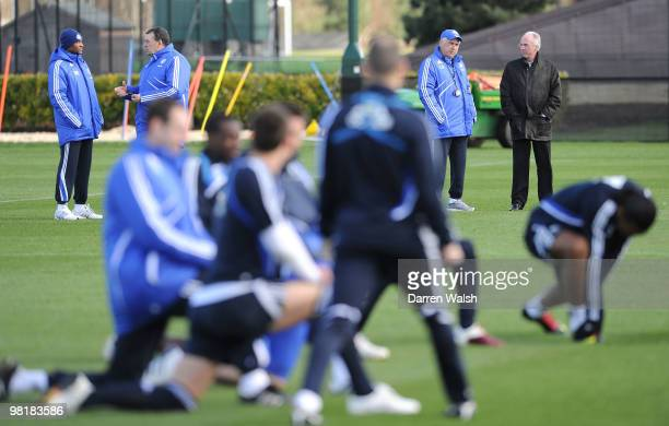 Chelsea manager Carlo Ancelotti talks to Ivory Coast manager Sven-Göran Eriksson as they watch during a training session at the Cobham Training...