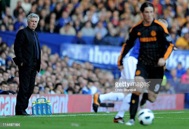 Chelsea Manager Carlo Ancelotti watches Fernando Torres during the Barclays Premier League match between Everton and Chelsea at Goodison Park on May...
