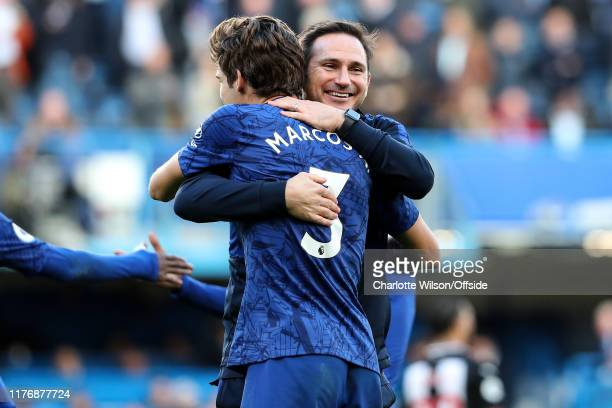 Chelsea manager Frank Lampard hugs goalscorer Marcos Alonso as they celebrate their victory during the Premier League match between Chelsea FC and...