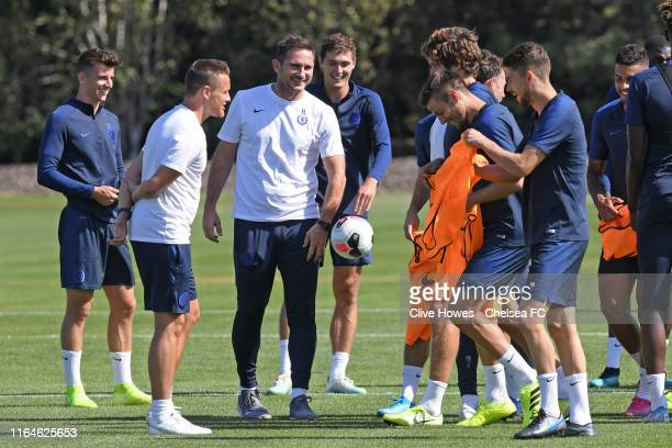 Chelsea Manager Frank Lampard jokes with players during the Open Training session at Chelsea Training Ground on August 29, 2019 in Cobham, England.