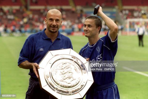 Chelsea manager Gianluca Vialli and captain Dennis Wise celebrate their team's victory with the Charity Shield