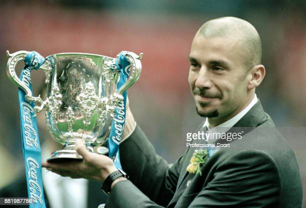 Chelsea manager Gianluca Vialli celebrates with the trophy after his team won the Coca Cola League Cup Final against Middlesbrough at Wembley Stadium...