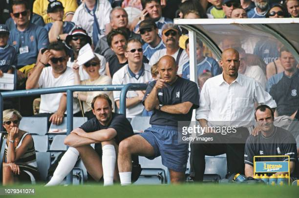 Chelsea manager Gianluca Vialli coach Ray Wilkins and substitute goalkeeper Ed de Goey look on from the bench during a Premiership match against...