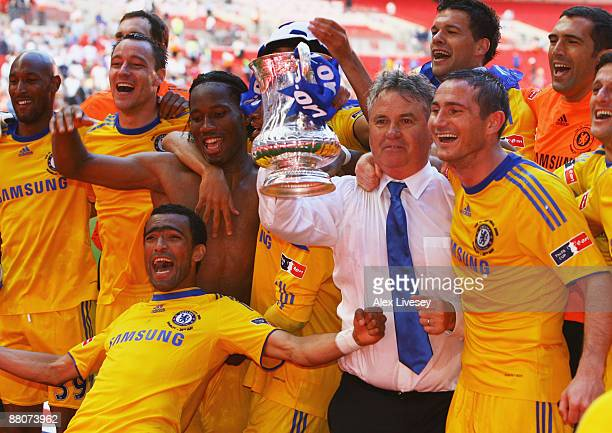 Chelsea manager Guus Hiddink and winning goalscorer Frank Lampard celebrate with team mates after the FA Cup sponsored by EON Final match between...