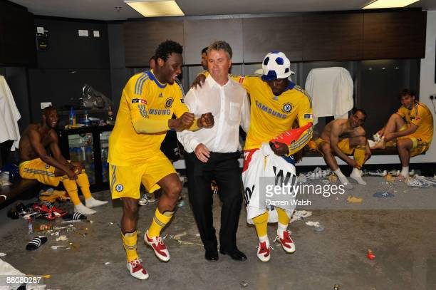 Chelsea Manager Guus Hiddink dances with John Obi Mikel and Michael Essien of Chelsea in the dressing room after the FA Cup sponsored by EON Final...
