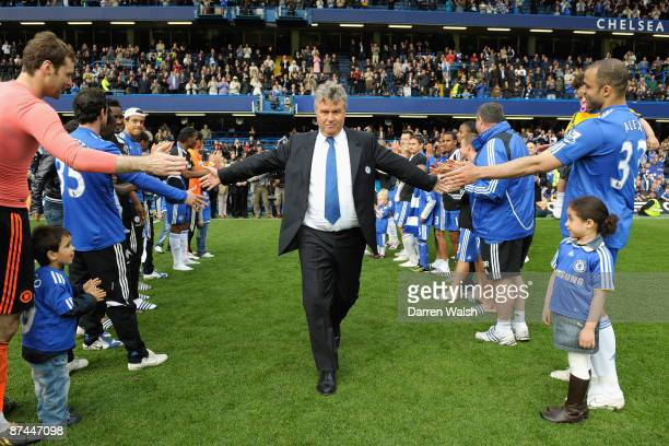 Chelsea Manager Guus Hiddink is given a guard of honour by his players and staff after the Barclays Premier League match between Chelsea and...