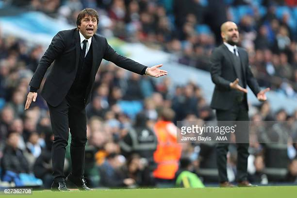 Chelsea Manager / Head Coach Antonio Conte and Pep Guardiola react during the Premier League match between Manchester City and Chelsea at Etihad...