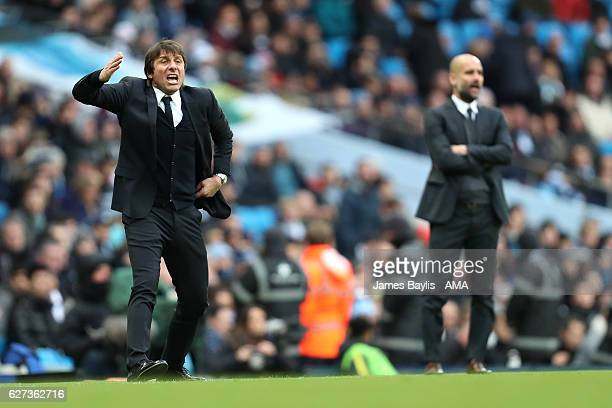 Chelsea Manager / Head Coach Antonio Conte reacts as Pep Guardiola looks on during the Premier League match between Manchester City and Chelsea at...