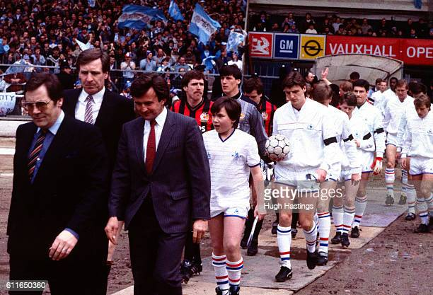 Chelsea Manager John Hollins and Manchester City Manager Billy McNeill lead out the teams