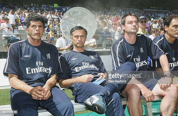 Chelsea Manager Jose Mourinho and Assistant Coaches Baltemar Brito and Steve Clarke try to keep cool during the Champion's World Series match between...
