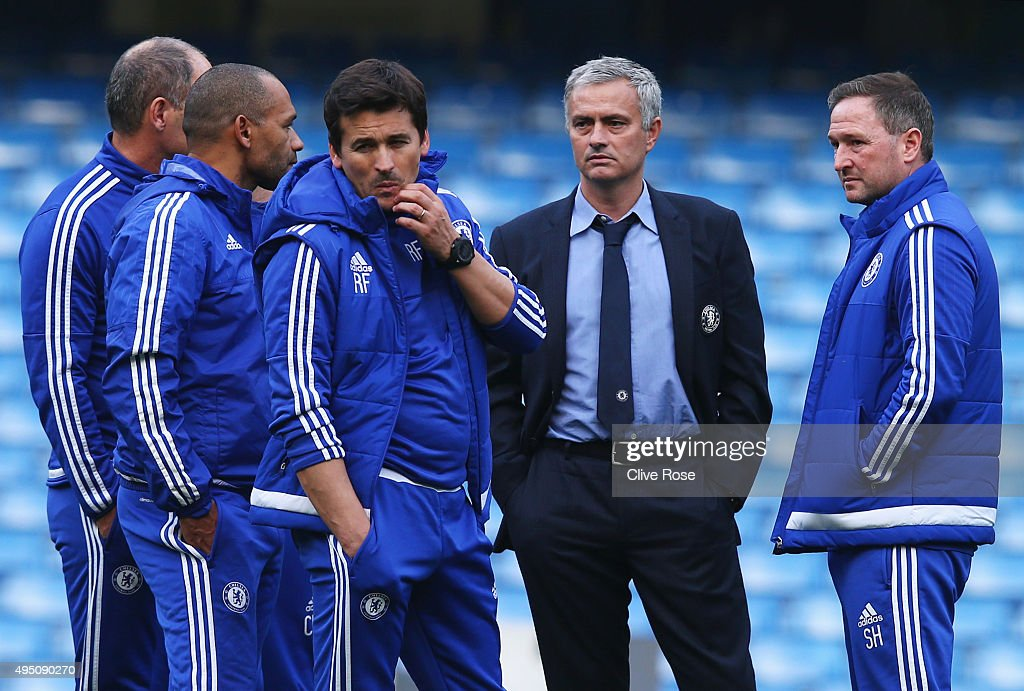 Chelsea manager Jose Mourinho and his staffs talk in the pitch after their team's 1-3 defeat in the Barclays Premier League match between Chelsea and Liverpool at Stamford Bridge on October 31, 2015 in London, England.