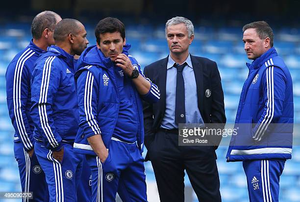 Chelsea manager Jose Mourinho and his staffs talk in the pitch after their team's 13 defeat in the Barclays Premier League match between Chelsea and...