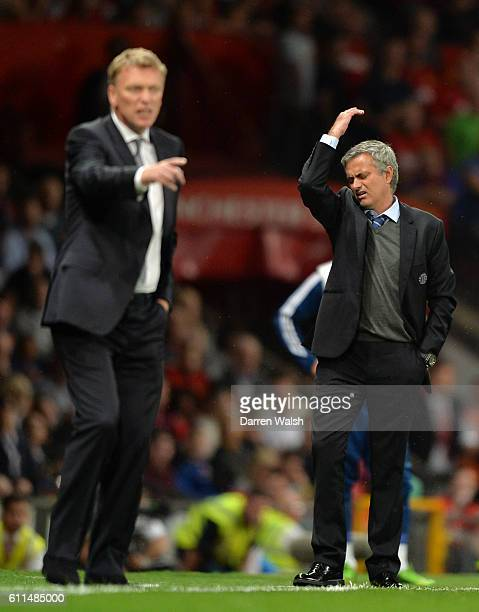 Chelsea manager Jose Mourinho and Manchester United manager David Moyes on the touchline