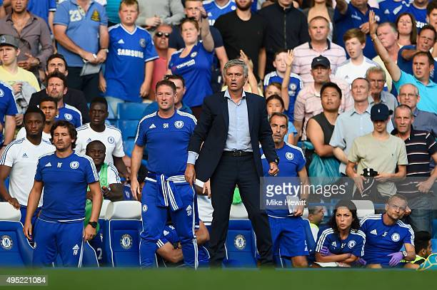 Chelsea manager Jose Mourinho and the Chelsea bench look on as Eden Hazard is fouled during the Barclays Premier League match between Chelsea and...