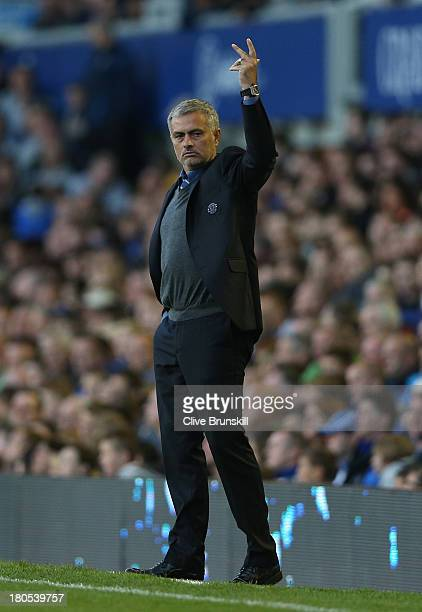 Chelsea Manager Jose Mourinho gestures during the Barclays Premier League match between Everton and Chelsea at Goodison Park on September 14 2013 in...