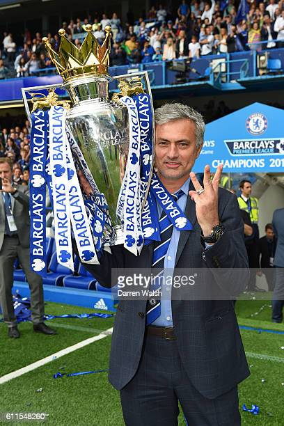Chelsea manager Jose Mourinho holds the Barclays Premier League trophy