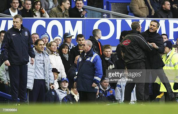 Chelsea Manager Jose Mourinho is restrained as he protests about Andy Johnson's penalty appeal whilst Everton Manager David Moyes looks on during the...