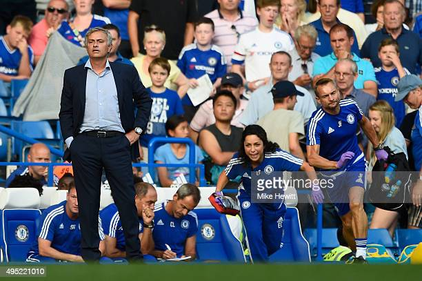 Chelsea manager Jose Mourinho looks on as team doctor Eva Carneiro rushes to treat Eden Hazard during the Barclays Premier League match between...