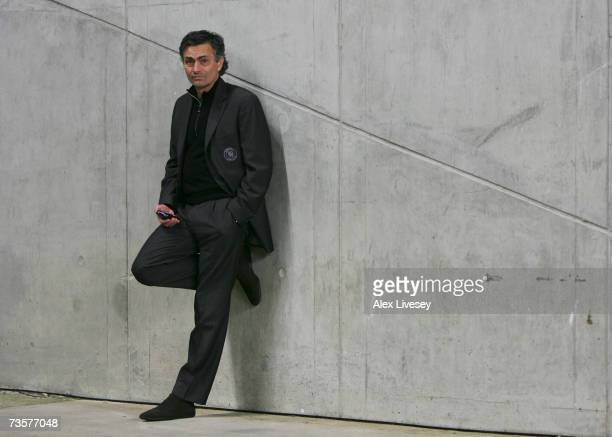 Chelsea Manager Jose Mourinho makes a phone call before boarding the team bus following his team's victory at the end of the Barclays Premiership...