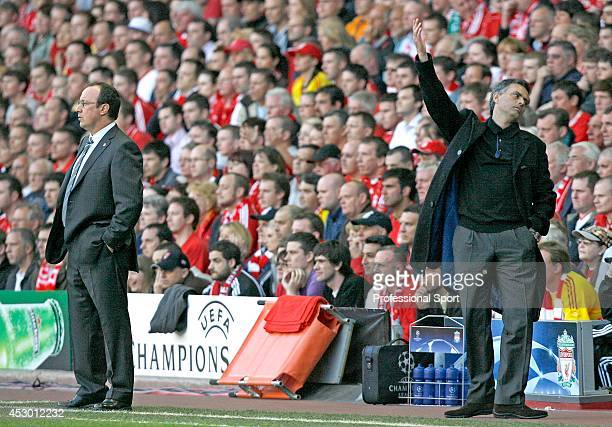 Chelsea manager Jose Mourinho reacts and Rafa Benitez of Liverpool standing on the touchline during the UEFA Champions League semi final second leg...