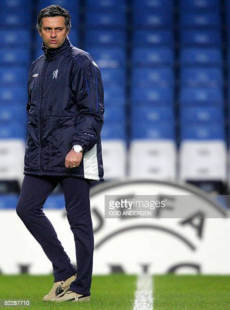 Chelsea manager Jose Mourinho watches his team during a training session at Stamford Bridge in west London 07 March 2005 on the eve of the second leg...