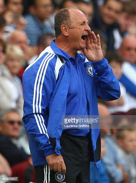 Chelsea Manager Luiz Felipe Scolari shouts instructions to his players during the Barclays Premier League match between Wigan Athletic and Chelsea at...