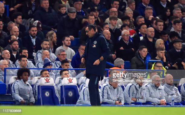 Chelsea manager Maurizio Sarri on the touchline with goalkeeper Kepa Arrizabalaga on the bench during the Premier League match at Stamford Bridge...