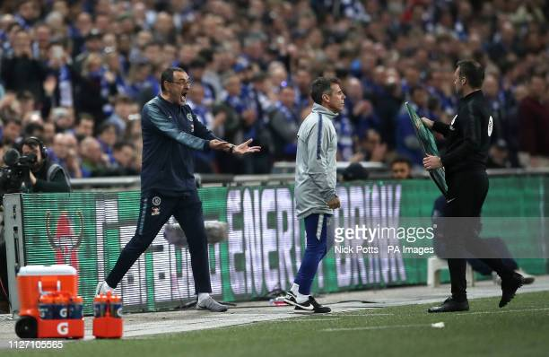 Chelsea manager Maurizio Sarri reacts as his goalkeeper Kepa Arrizabalaga refuses to leave the pitch after his proposed substitution during the...