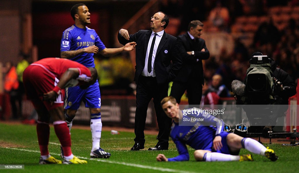 Chelsea manager Rafa Benitez (c) reacts as forward Fernando Torres (r) ends up on the floor after a challenge during the FA Cup Fifth Round match between Middlesbrough and Chelsea at Riverside Stadium on February 27, 2013 in Middlesbrough, England.