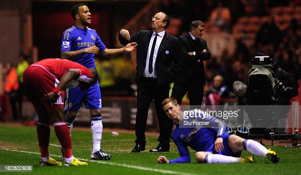 Chelsea manager Rafa Benitez reacts as forward Fernando Torres ends up on the floor after a challenge during the FA Cup Fifth Round match between...