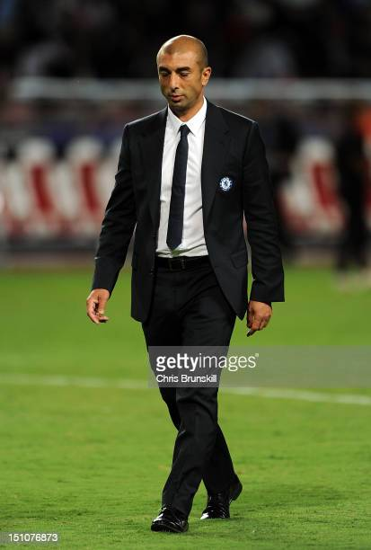 Chelsea manager Roberto Di Matteo looks dejected as he leaves the field at halftime during the UEFA Super Cup match between Chelsea and Atletico...