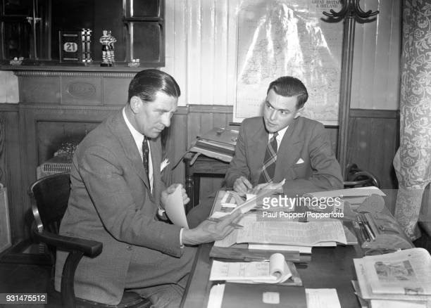 Chelsea manager Ted Drake being interviewed by the club's programme editor Albert Sewell at Stamford Bridge in London 21st June 1955