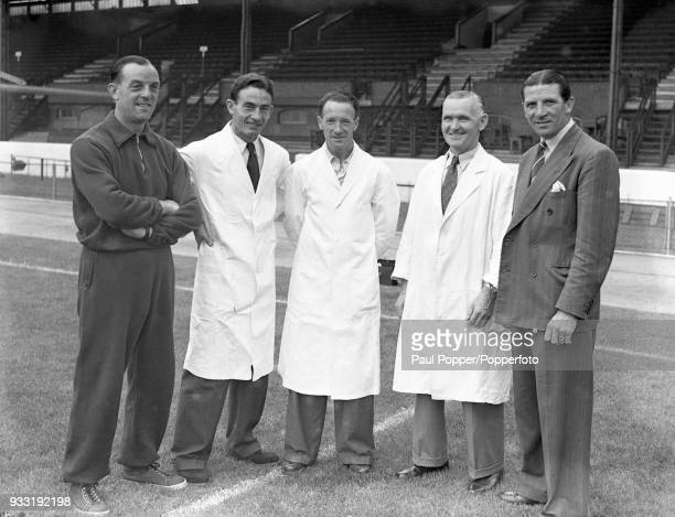 Chelsea manager Ted Drake with his backroom staff Albert Tennant Harry Medhurst Dick Spence Jack Oxberry and Ted Drake at Stamford Bridge in London...