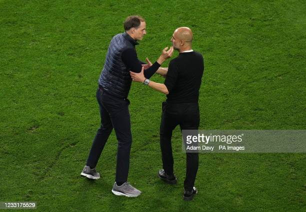 Chelsea manager Thomas Tuchel and Manchester City manager Pep Guardiola shake hands after the UEFA Champions League final match held at Estadio do...