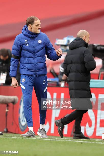 Chelsea manager Thomas Tuchel celebrates victory alongside a dejected Manchester City manager Pep Guardiola at the end of the Semi Final of the...