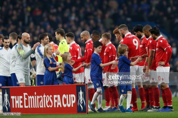 Chelsea mascots shake hands with the players before the start of the English FA Cup third round football match between Chelsea and Nottingham Forest...