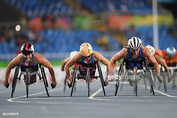 Chelsea McClammer Amanda McGrory and Tatyana McFadden of the United States crosses the finish line in the Women's 1500m T54 Final on day 6 of the Rio...