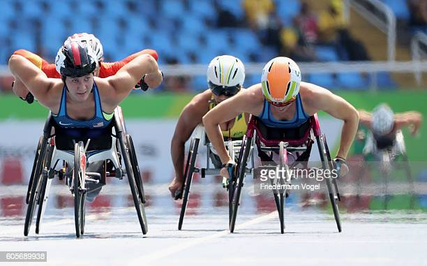 Chelsea McClammer and Amanda McGrory of the United States compete in the Women's 5000m T54 Heat on day 7 of the Rio 2016 Paralympic Games at the...